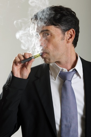 puffing: Man smoking electronic cigarette