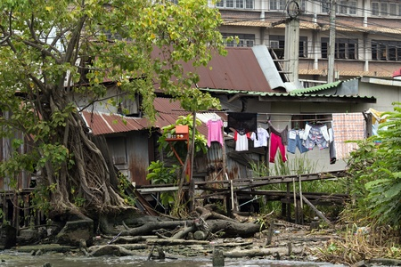 Shanty wooden house in Bangkok Klongs ghetto, Thailand photo