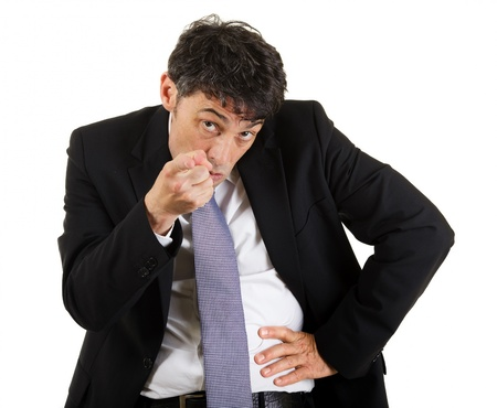 identifying: Businessman pointing an accusatory finger at the camera identifying and blaming the viewer, upper body portrait isolated on white Stock Photo