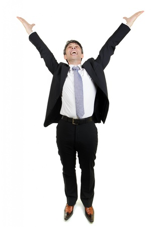 Jubilant businessman rejoicing an achievement stretching his arms in the air and cheering in excitement and elation, full body portrait isolated on white
