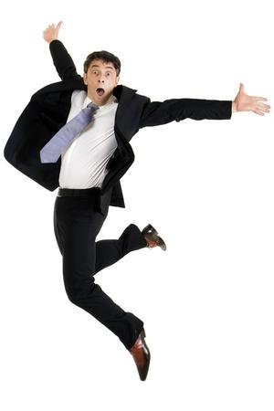 Agile stijlvolle zakenman van middelbare leeftijd die in de lucht van vreugde op wit wordt geïsoleerd Stockfoto