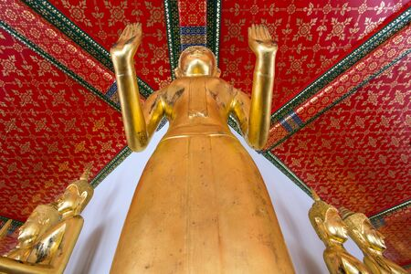 Gilded Buddha statue view from above with diminishing perspective in Wat Pho temple in Bangkok, Thailand