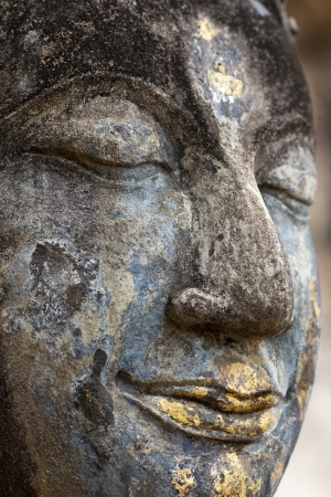 Head detail of old Buddha statue in the Wat Saphan Hin temple in Sukhothai historic park, Thailand photo