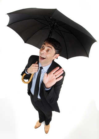 exultant: Man under an umbrella having an inspirational breakthrough looking up with his hand raised and a look of ecstatic wonderment on his face, comic high angle portrait isolated on white Stock Photo