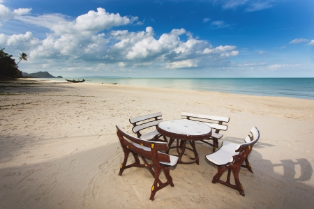 Table and seats on deserted and relaxing tropical Khanom beach, Thailand photo