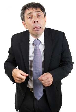 woebegone: Grief-stricken businessman crying standing looking at the camera with a pitiful woebegone expression , isolated on white