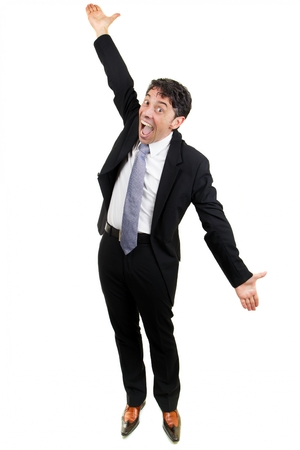 jubilation: Excited middle-aged businessman in a suit celebrating an achievement or success cheering and raising his arms in the air in jubilation isolated on white