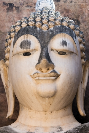 chum: Head detail of old Buddha statue in the Wat Si Chum temple in Sukhothai historic park, Thailand