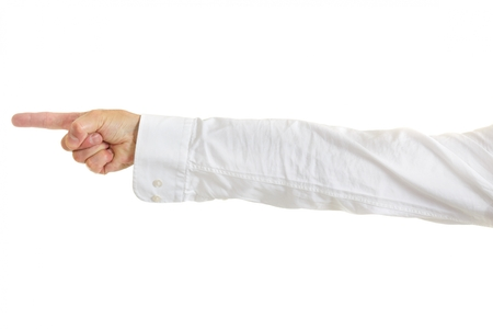 Mans hand and arm in shirtsleeves pointing to the left of the frame, isolated on white photo