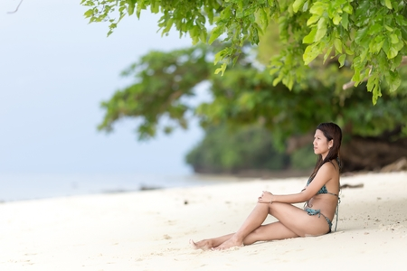 Beautiful Filipina woman sitting in her bikini  photo