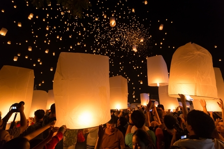 CHIANGMAI THAILAND NOVEMBER 16  : thai people launching sky lantern for Yi Peng buddhist Festival on november 16, 2013 Chiangmai, Thailand