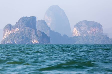Foggy limestone cliff  tropical sea landscape in Phang nga bay, Thailand