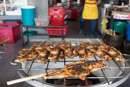 Asian chicken brochettes in a street restaurant, Thailand