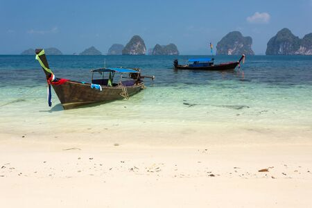 pang: Longtail boat on tropical white sand shore in the Pang nga bay, Thailand