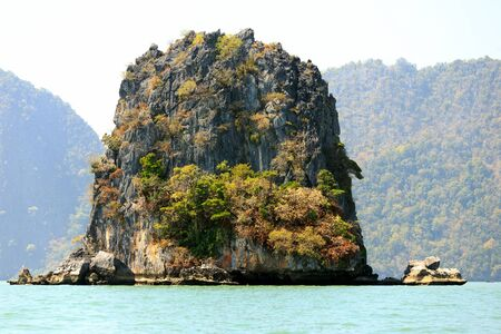 steep cliff: Steep limestone island in the Pang nga bay, Thailand Stock Photo