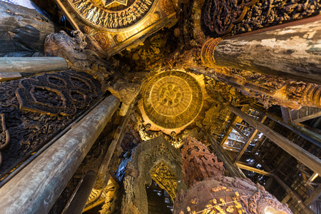 Interior of a wooden Buddhist temple, The Sanctuary of Truth in Pattaya, Thailand