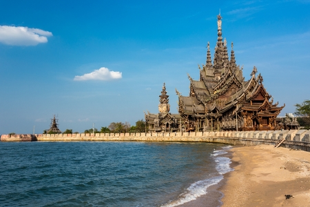 The wooden sanctuary of truth, buddhist, chinese, and hinduist temple in Pattaya, Thailand photo