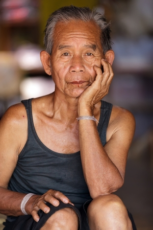 bam: BAM MUANG PAM, THAILAND, NOVEMBER 22 : close portrait of an old Karen tribe man, Thai ethnicity, in the village of  Bam Muang Pam, north Thailand on November 22, 2012 Editorial