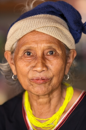 BAM MUANG PAM, THAILAND, NOVEMBER 22 : close portrait of an old Karen tribe woman, Thai ethnicity, in the village of  Bam Muang Pam, north Thailand on November 22, 2012