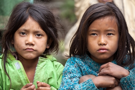 MUKTINAH, NEPAL, NOVEMBER 13 : two little Nepalese girls posing in the  Muktinah village, Annapurna , Nepal on 13 November 2010