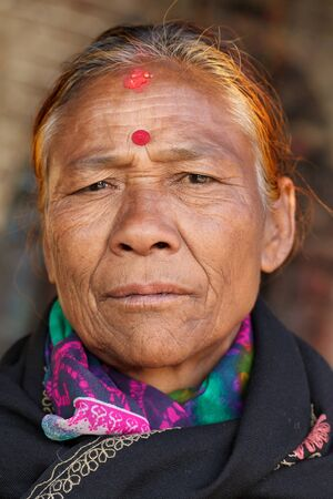 third age: BHAKTAPUR, NEPAL, NOVEMBER 26 : close portrait of an old Nepalese woman in  Bhaktapur, Nepal on 26 November 2010