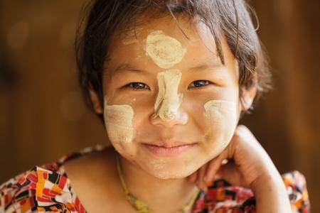 UMPHANG,THAILAND, DECEMBER 01 : Unidentified Burmese little girl portrait in a refugee village near Umphang, North Thailand on December 01, 2012