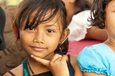 BUKIT LAWANG,INDONESIA, July 07 : Unidentified little girl posing among her friends in the Bukit Lawang village, Sumatra, Indonesia, on July 07, 2010 Editorial