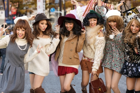 TOKYO,JAPAN, November 25 : A group of girls is posing in the middle of the street for fashion advertising in the street near the Shibuya crossroad in Tokyo, Japan, on November 25, 2011 Editorial