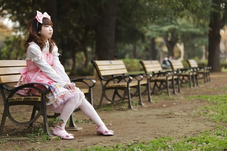 lolita: Japanese girl in lolita cosplay fashion sitting on a bench, Tokyo Stock Photo