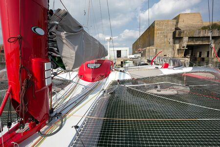 onboard: Large and luxurious catamaran anchored in the Lorient port, ready for a world boat race starting from Saint Malo, Brittany, France Stock Photo