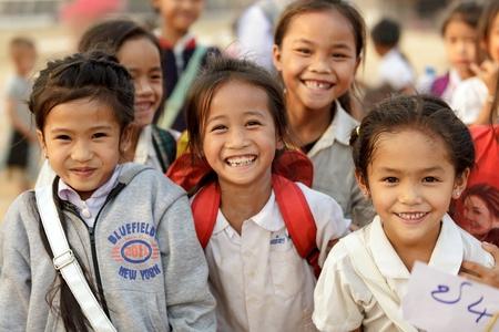 SAYABURI, LAOS, FEBRUARY 16, 2012 :Happy Loatian little girls posing in the schoolyard during the Elephant festival in Sayaburi, Laos Editorial