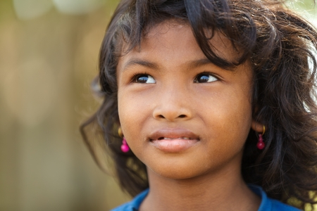SIEM REAP, CAMBODIA, DECEMBER 04, 2012 : Cambodian little girl portrait in a village near Siem Reap, Cambodia.