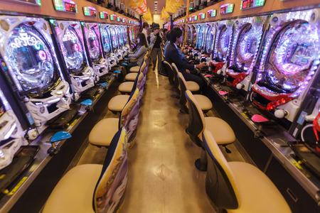 KYOTO, JAPAN, NOVEMBER 15, 2011: Some customers are gambling in a Pachinko hall, traditional Japanese Game in Kyoto, Japan Editorial