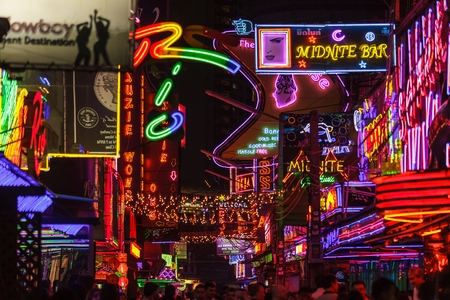prostitution: BANGKOK, THAILAND, JANUARY 31, 2012: View on the colorful neon lightings filling the Soi Cowboy street in the red entertainment district of Nana in Bangkok, Thailand