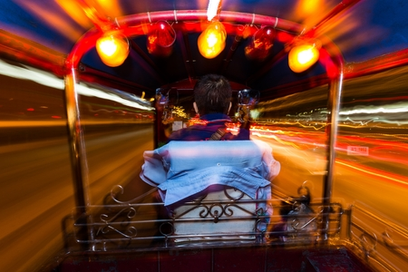 tuk tuk: Dynamic perspective and long time exposure inside a Tuk tuk vehicle in Bangkok, Thailand