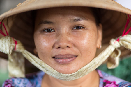 can tho: CAN THO, VIETNAM, DECEMBER 11, 2014:Portrait of a woman selling soya milk in the covered Tan An market in Can Tho city, Vietnam. Stock Photo