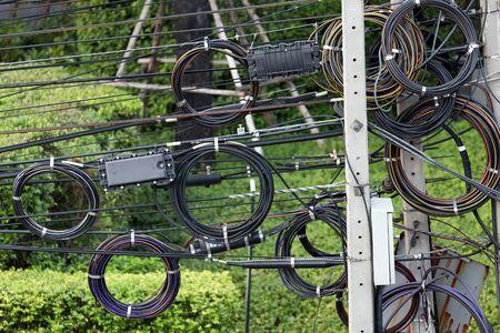 disorganization: Electric cables messy tangled in Bangkok, Thailand Stock Photo