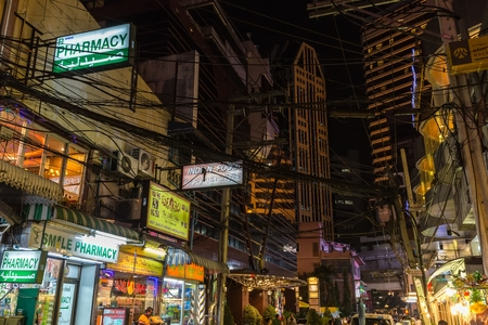 nana: BANGKOK, THAILAND, JANUARY 14, 2015: Evening messy atmosphere in the Sukhumvit Soi 5,Nana District in Bangkok, Thailand Editorial