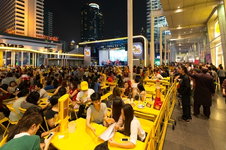center table: BANGKOK, THAILAND, DECEMBER 25, 2014: Thai people are celebrating Christmas at a outdoors restaurant in the Central World plaza in Bangkok, Thailand.