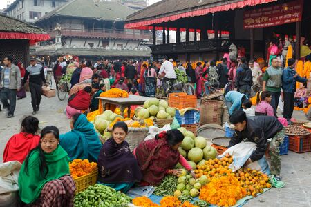 3rd ancient: KATHMANDU,NEPAL,NOVEMBER 04,2010: Early morning market activity in the Historical Patan Durbar square in Kathmandu, Nepal. This place has been heavily damaged the 25 April 2015 by a terrible earthquake.