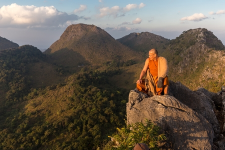 buddhist monk: CHIANG DAO, THAILAND, JANUARY 05, 2015: A Buddhist monk master is meditating at the top of the Chiang Dao mount at dusk for the new year in Thailand.