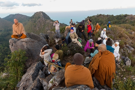 CHIANG DAO, THAILAND, JANUARY 05, 2015: Group of Buddhist people and monks trekking at the top of the Chiang Dao mount for the new year meditation in Thailand.