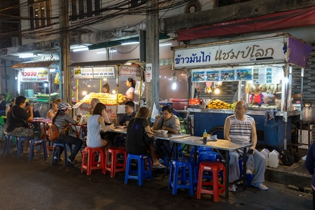 thong woman: BANGKOK, THAILAND, February 16, 2015: Some customers are sitting at the restaurant tables in the Sukhumvit Soi 38, famous place of street food in the Thong Lor district in Bangkok, Thailand