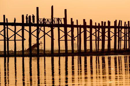 teck: U bein wooden teck bridge at dusk in Myanmar Stock Photo