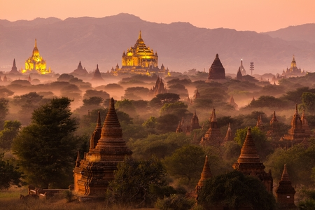 Pagoda landscape under a warm sunset in the plain of Bagan, Myanmar (Burma) Stock Photo