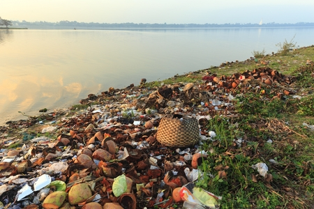 river bank: Rubbish pollution with plastic and other packaging stuffs on the bank of the Taungthaman lake near U Bein bridge in Myanmar (Burma)