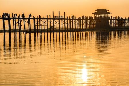 silhouetted: U bein wooden teck bridge silhouetted at dusk in Amarapura, Myanmar (Burma)