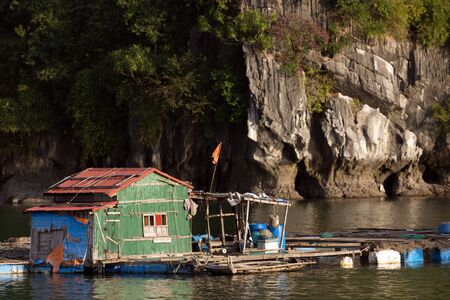 halong: Traditional floating fisher house in Halong bay in Vietnam