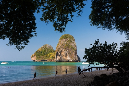 phra nang: Tropical  Phra Nang beach landscape with silhouetted trees, Thailand Stock Photo