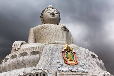 big island: The Phuket Big Buddha at the top of the hill under a stormy sky Stock Photo